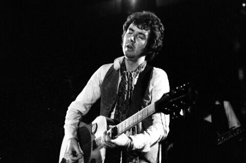 Ronnie Lane playing guitar